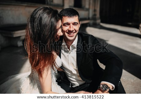 Brides embrace in the hall - stock photo