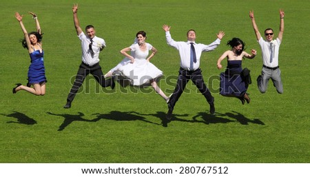 Brides on the pitch. green grass. friends, happy emotions - stock photo
