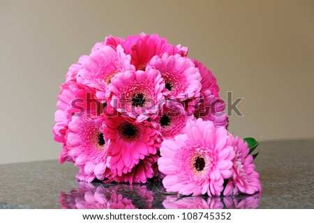 Brides pink bouquet and grooms buttonhole - stock photo
