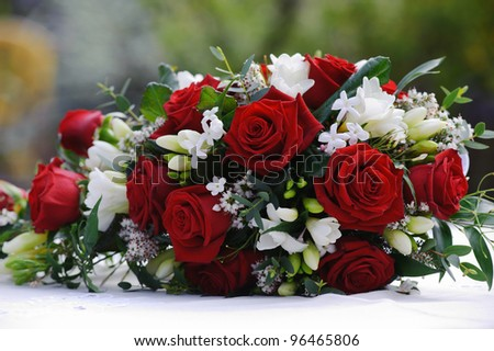 Brides red roses at wedding