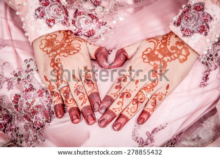 brides ring with a henna hand at a Malay wedding. close up. - stock photo