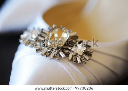 Brides shoe detail closeup - stock photo