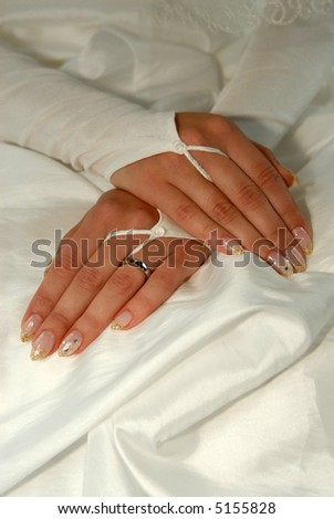 Brides white hands with the ring - stock photo