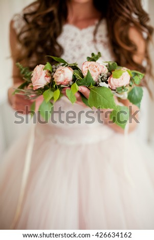 brides wreath in the hands - stock photo