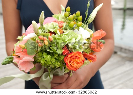 bridesmaid holding the wedding bouquet - stock photo