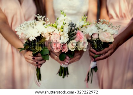 bridesmaid with flowers at the wedding - stock photo