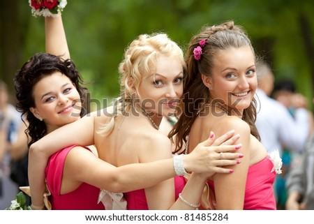 Bridesmaids at wedding ceremony - stock photo