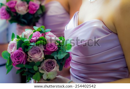 Bridesmaids Holding Colorful Wedding Bouquets - stock photo