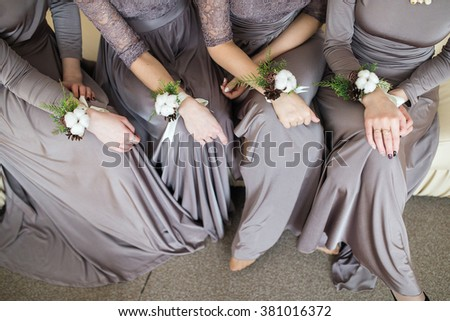 bridesmaids with wedding bouquet of flowers at  bridal ceremony. bridesmaids with boutonniere buttonhole at wedding day. bride friends with marriage flowers wedding. woman with wedding hands flowers - stock photo