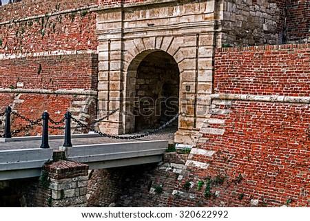 Bridge access, entrance and stone wall of the fortress Kalemegdan, Belgrade, Serbia. - stock photo