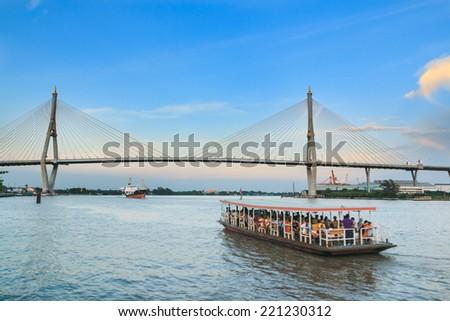 Bridge across big  river with blue sky background - stock photo