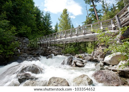 Bridge Across Glacial Stream - stock photo