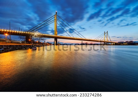 Bridge across river at night with artificial lightning, Belgrade Serbia - stock photo