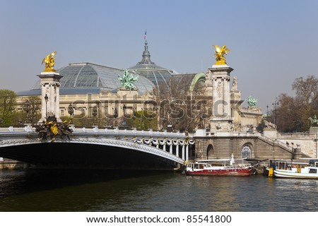Bridge Alexander III, and the Grand Palace in the background. Paris, France. - stock photo