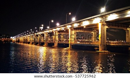 Bridge along the river at night
