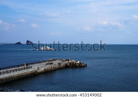 Bridge and Boat in Sea with Blue Sky