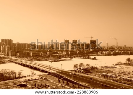 bridge and building scenery after the snow, luannan county, china