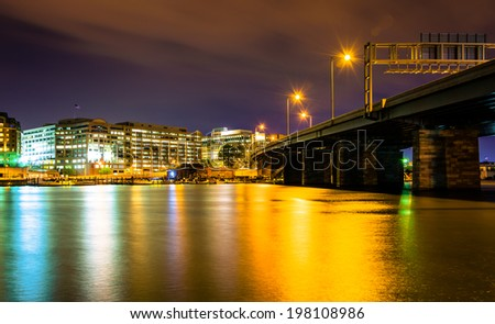 Bridge and buildings along the Washington Channel at night, in Washington, DC. - stock photo