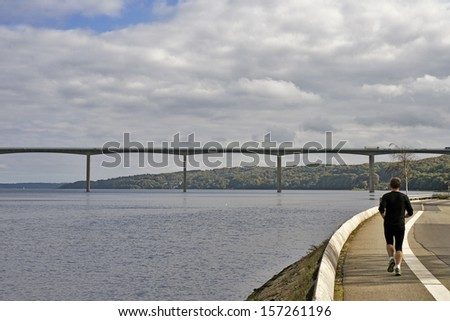 Bridge and runner  - stock photo