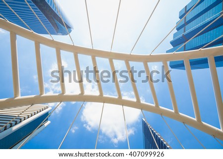 Bridge and skyscrapers in the city of Bangkok. Background is the tallest building in the business district of Bangkok. - stock photo