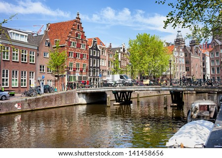 Bridge and traditional Dutch houses on Oudezijds Voorburgwal canal, city of Amsterdam, Netherlands. - stock photo