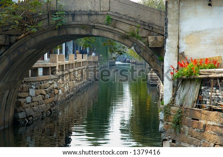Bridge arch and traditional Chinese houses on a river. More with keyword Series11A. - stock photo