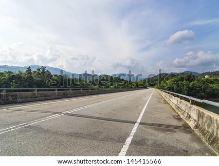 bridge asphalt road in mountain hill - stock photo