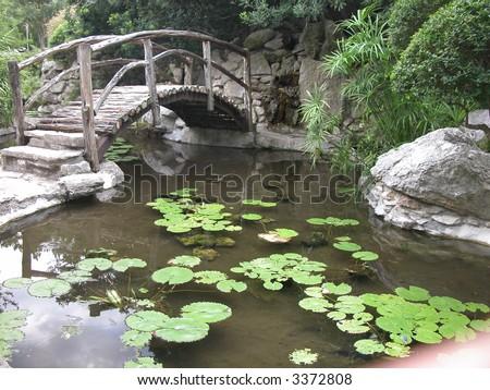 bridge at the Taniguchi Japanese garden in Zilker park Austin Texas - stock photo
