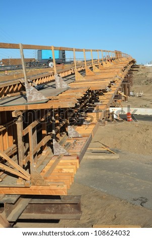 Bridge Construction Project: Temporary wood forms, safety handrails and steel reinforcing bars are in place and ready to receive poured concrete