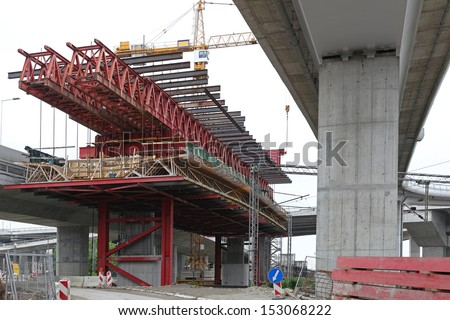 Bridge construction with scaffolding forms over intersection road