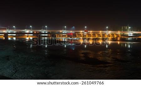 Bridge crossing Fox River in DePere, Wisconsin  - stock photo