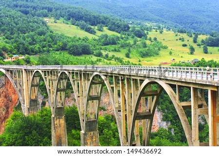 Bridge Djurdjevica in Montenegro over the Tara Canyon - stock photo