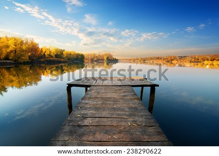 Bridge for fishing in sunny autumn day - stock photo