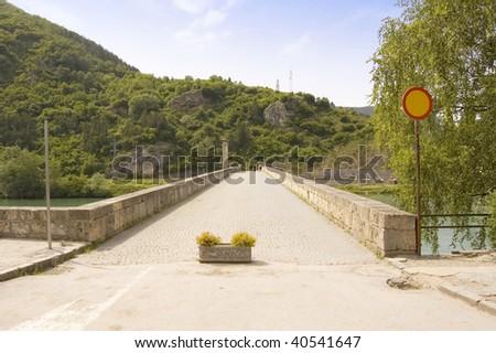 Bridge for walking on river Drina in Visegrad in Bosnia - stock photo