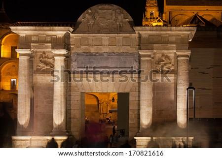 Bridge Gate (Spanish: Puerta del Puente) illuminated at night in Cordoba, Andalusia, Spain. - stock photo