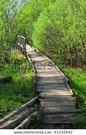 bridge in a spring forest - stock photo