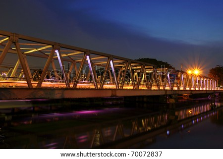 Bridge in blue hour after sunset at Cisadane river, Tangerang, Indonesia - stock photo
