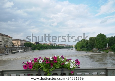 bridge in turin through river Po to Basilica di Gran Madre during flooding in spring