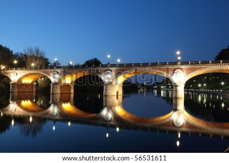 Bridge isabella historic bridge over the river while passing through the city of Turin Italy - stock photo