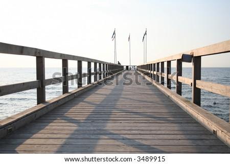 bridge leading to dock - stock photo
