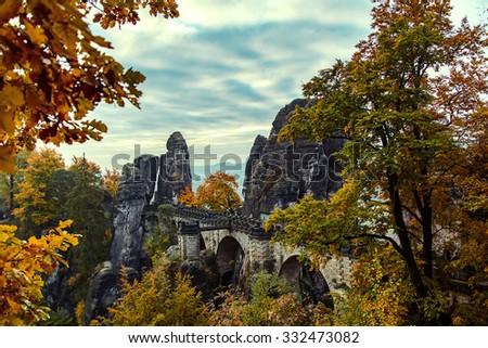 Bridge named Bastei in Saxon Switzerland,  the mist over the river Elbe, National park Saxon Switzerland.. - stock photo