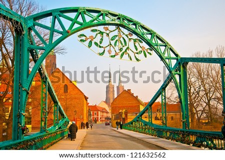Bridge of lovers and cathedral during Christmas in Wroclaw, Poland - stock photo