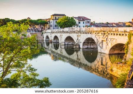 Bridge of Tiberius (Ponte di Tiberio) in Rimini, Italy. - stock photo