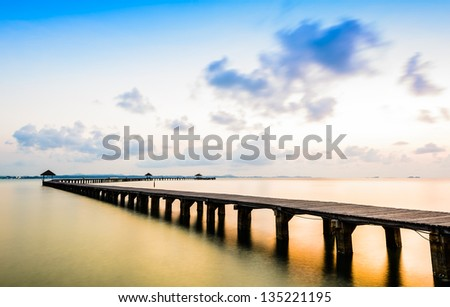 Bridge on beach in sunrise and sea wave in asia ocean