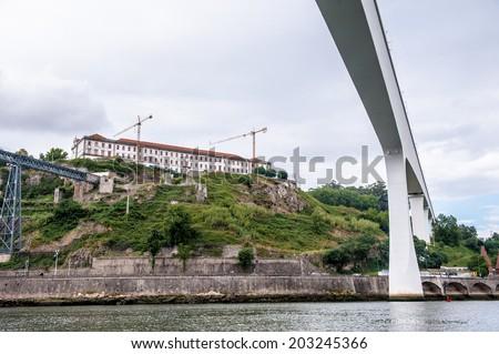 Bridge ove the River Douro in Porto, Portugal. View from the River Douro, one of the major rivers of the Iberian Peninsula (2157 m) - stock photo