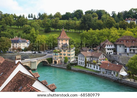 Bridge over  Aare river and colorful town houses in Bern's Old Town district, Switzerland