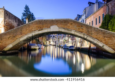 Bridge over canal at dusk in Venice, Italy - stock photo