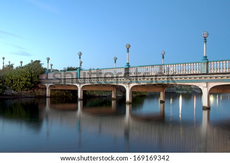 Bridge over lake in the evening - stock photo