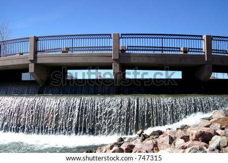 Bridge over man made river through Pueblo, colorado. - stock photo