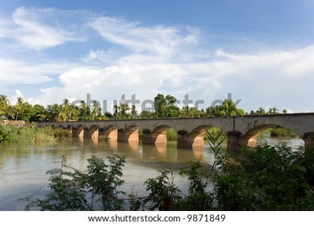bridge over mekong river - stock photo